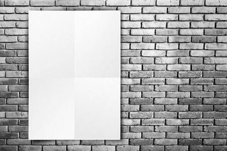Black White paper poster hanging at grunge brick wall,Template mock up for adding your text.. photo