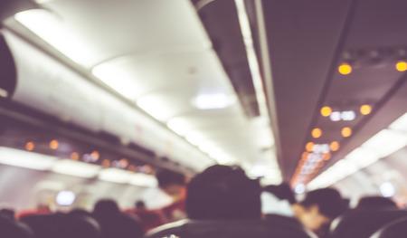 caba�a: Fondo borroso: pasajero en avi�n. Foto de archivo