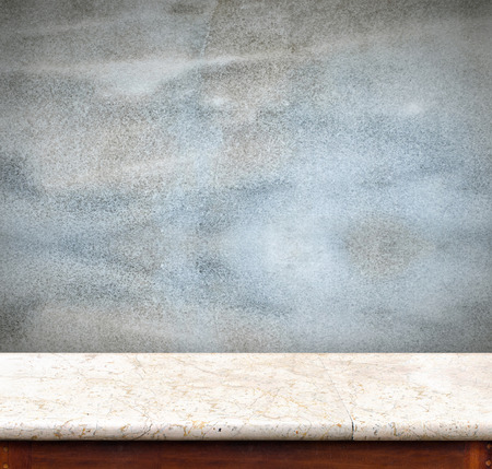 decoraton: Empty marble table and blue concrete wall in background,product display business template