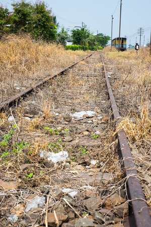 vacant land: Vacant Rail way switch track with yellow die grass. Stock Photo