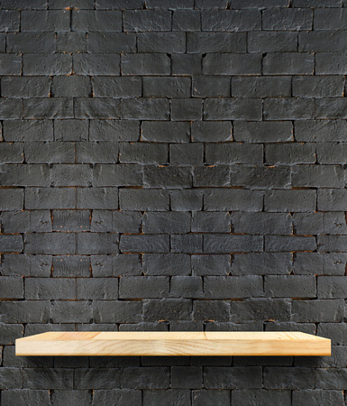 Empty Wooden shelf at black brick wall,Template mock up for display of product,business presentation. photo