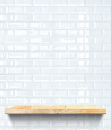 Empty Wooden shelf at white tile ceramic wall,Template mock up for display of product,business presentation