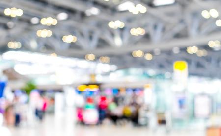 terminal: Blurred background : Traveler at airport terminal blur background with bokeh light.