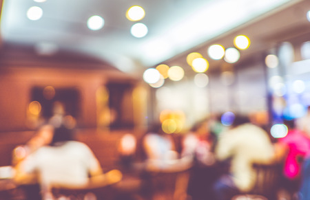 at leisure: Blurred background : Customer at restaurant blur background with bokeh. Stock Photo