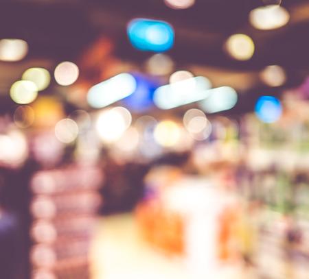 retailer: Blurred background : Supermarket store blur background with bokeh.