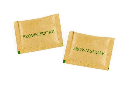 sachet: brown sugar sachet isolated on white background.