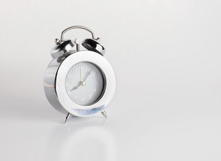 sliver: sliver alarm clock on gery background. Stock Photo