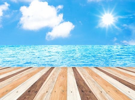 blue sea: Sunny day with blue sky at sea on wooden pier