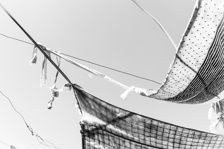 an awning: Black and white photo,old cloth awning at sky