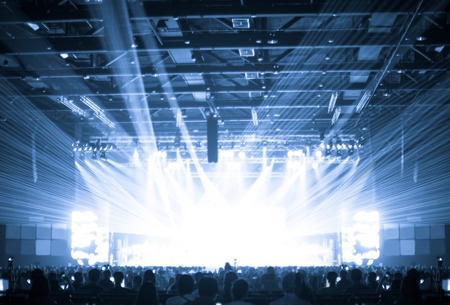 stage spotlight: Blurred background : Bokeh lighting in concert with audience ,Music showbiz concept.