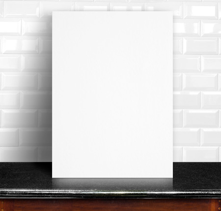 frame wall: Black White paper poster lean at white ceramic tiles wall and marble table,Template mock up for adding your design
