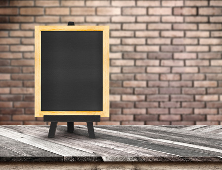 brick wall background: Menu blackboard on Diagonal Wooden Table top at blurred red brick wall,Template mock up for display of your product,Business presentation.