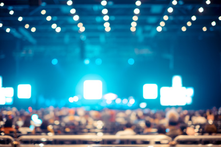 concert background: Blurred background : Bokeh lighting in concert with audience ,Music showbiz concept.