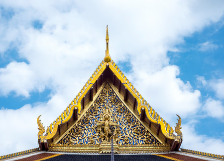 buddhist temple roof: Thai Temple with ornament art roof top at blue sky,Bangkok Thailand.