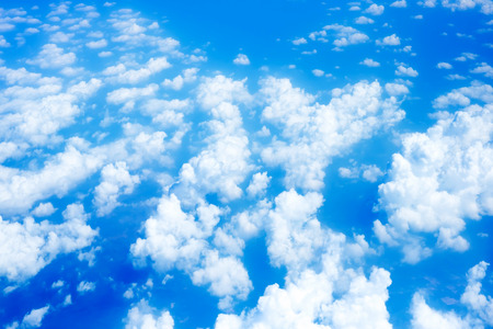 bird eye view: Aerial view of Blue sky and Cloud Top view from airplane window,Nature background. Stock Photo