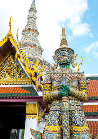 rich people: Looking up at giant statue at Grand palace, Temple of the Emerald Buddha (Wat pra kaew) in Bangkok ,Thailand Stock Photo