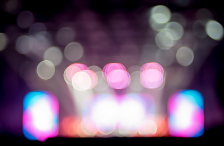 concert: Blurred background : Bokeh lighting in concert with audience ,Music showbiz concept.