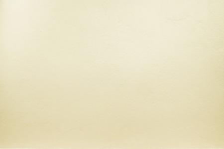 Textuur: geel pastel kleur verf op de betonnen muur, textuur achtergrond.