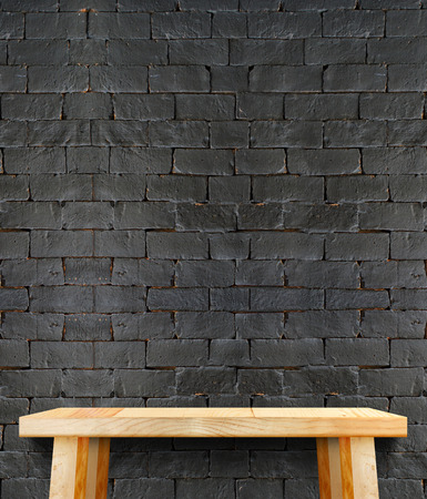 kitchen table top: Blank modern wooden table with leg at black brick wall ,Template mock up for display of product,
