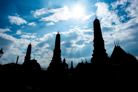lining: silhouette photo of Thai pagoda with sun beam,sky and cloud.