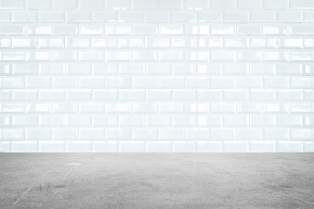 tile pattern: Room perspective,white ceramic tile wall and cement ground.