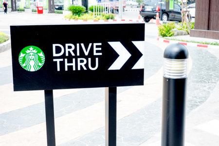 thru: Bangkok ,Thailand-March 20 :Starbucks drive thru sign on 20 March 2015 at The community mall, Bangkok, Thailand.