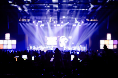 light spot: Blurred background : Bokeh lighting in concert with audience ,Music showbiz concept.