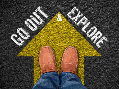 to move forward: Inspiration quote :  go out & explore on aerial view of shoe on road with move forward yellow arrow ,Motivational typographic. Stock Photo