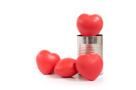 charity relief work: group of red heart in metal can isolated on white background,Charity concept.