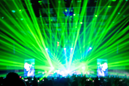laser show: Blurred background : Bokeh lighting in concert with audience ,Music showbiz concept.