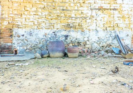 brick building: stone wall outside house,abandoned land.