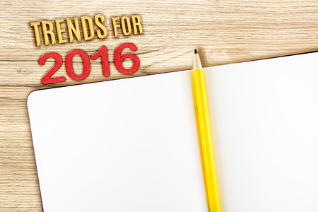 notebook design: Trend for 2016 year with open notebook on wooden table, Mock up for adding your design.