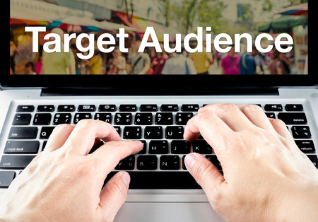 Target audience word on laptop screen with hand type on keyboard, Digital Marketing concept.