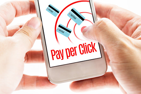 pay phone: Close up Two hand holding mobile with Pay per click word, Digital marketing concept.
