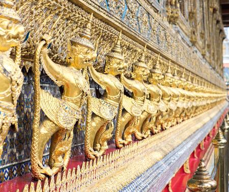 garuda: Gold Garuda wall at thai templte. Stock Photo