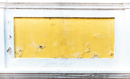 cracked concrete: cracked yellow paint color concrete wall,texture background. Stock Photo