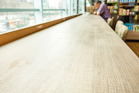 Empty wood table and blurred cafe light background. product display template.Business presentation