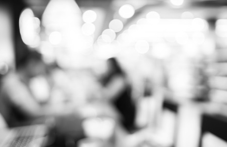 blurred people: Blurred background : black and white filter ,Customer in Coffee shop blur background with bokeh. Stock Photo