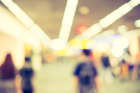 baggage: Blurred background : Traveler with baggage at airport terminal blur background with bokeh light. Stock Photo