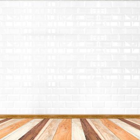 tile flooring: Empty white tile wall and wooden flooring,mock up for display of product. Stock Photo