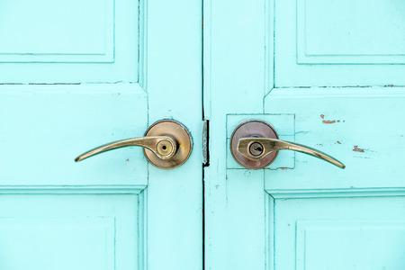 blue door: close up Brass door handle at wood blue door. Stock Photo