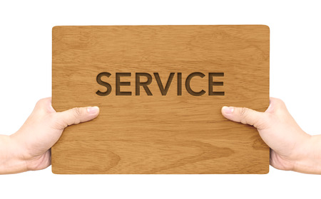 up service: Hand holding dark brown wood signboard with service word isolated on white background,Business concept.