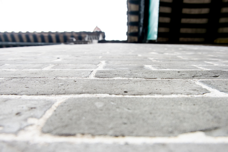 looking up: perspective angle of stone wall looking up at roof. Stock Photo