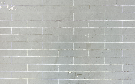 grey background texture: Grey brick wall texture background.