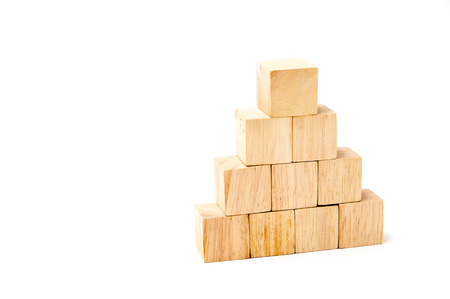 wood cube arrange in pyramid shape ,business concpt.
