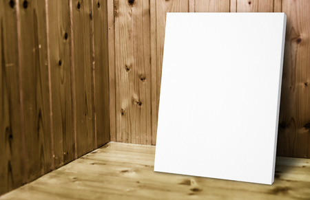 conner: Blank white poster leaning at wooden wall in plank wood room,Mock up for adding your content