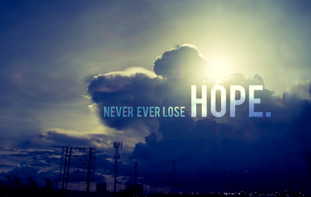 hope: Inspiration quote :  Never ever lose hope with sun burst behind cloud,Motivational typographic. Stock Photo