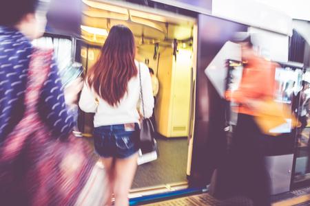 go inside: Blurred background, People travel at sky train bangkok, transportation background.