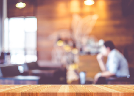 up: Empty wood table with blur coffee shop background,Mock up Template for display of product. Stock Photo