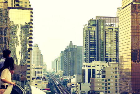business center: Cityscape view of bangkok , people at high business building,vintage filter.